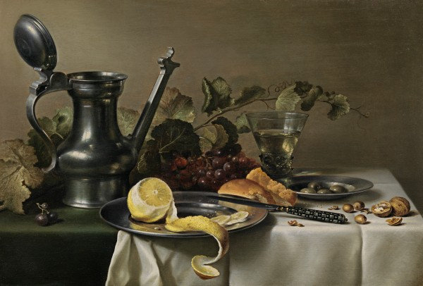 Still life with a pewter jug, a peeled lemon on a pewter plate, bread, a knife, a berkemeyer and vine leaves on a table partly draped with a white cloth